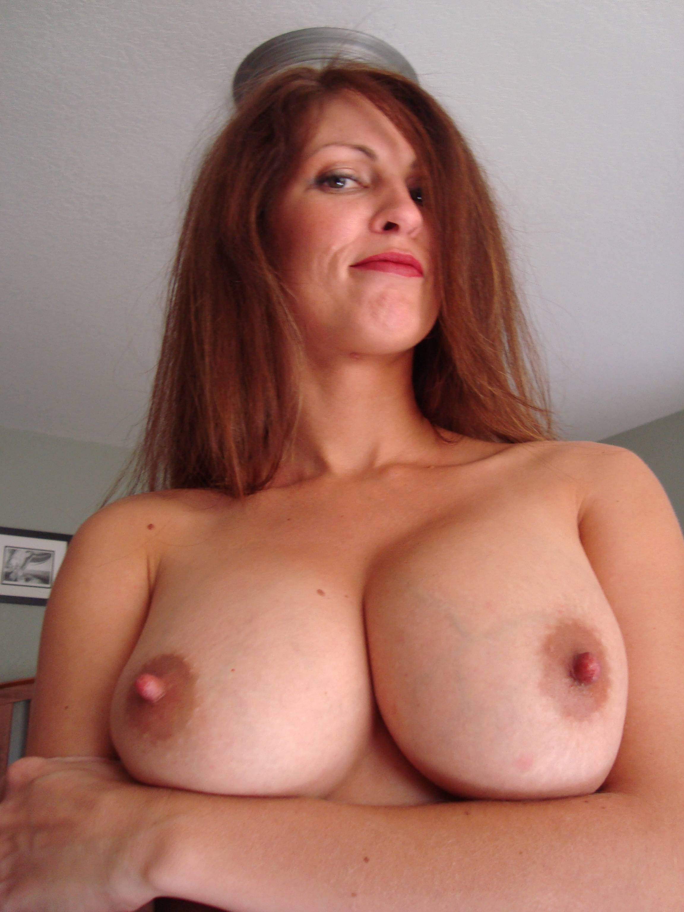 Gorgeous amateur mature wife showing her big natural boobs