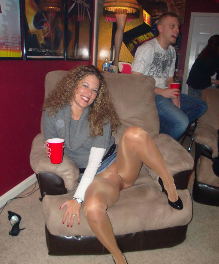 Drunk chick sits on chair exposing naked pussy