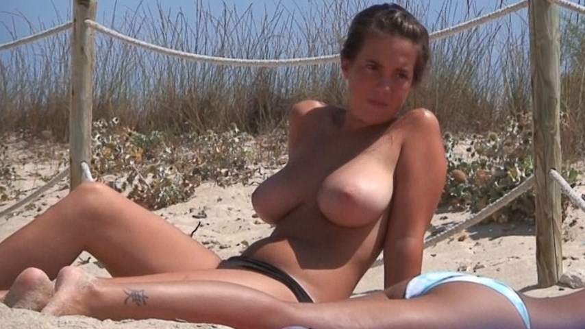 Busty brunette babe topless on the beach