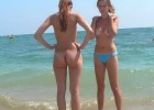 Sweet chicks naked on the sea shore