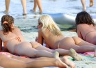 Group of friends sunbathing in thong bikinis