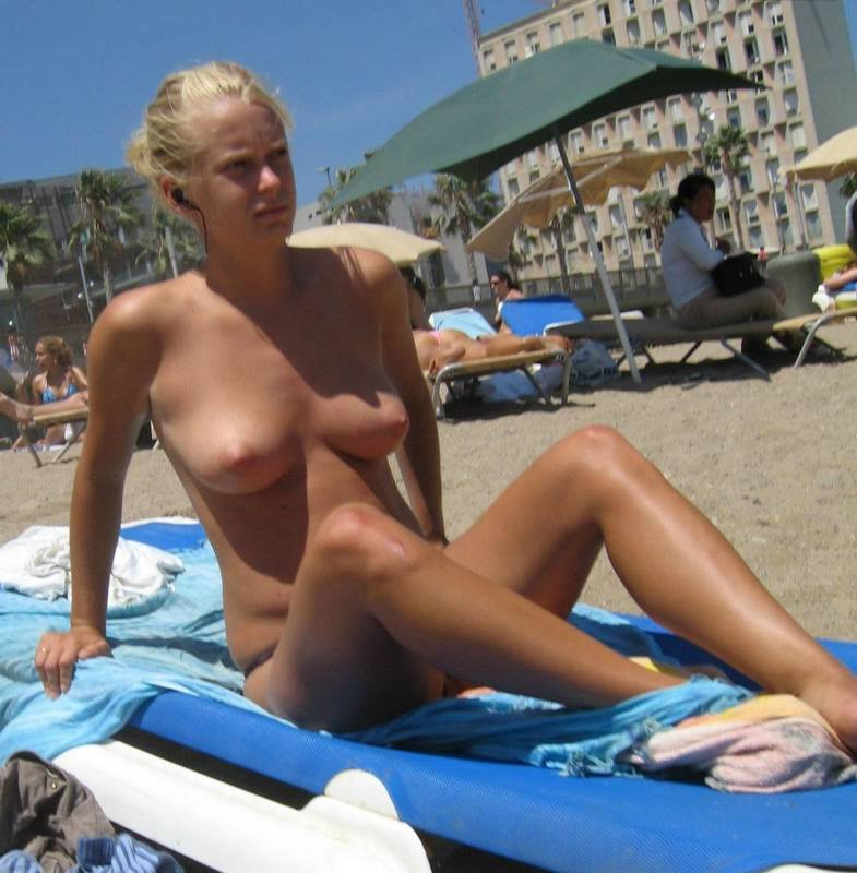 Topless blond beauty tanning at sun