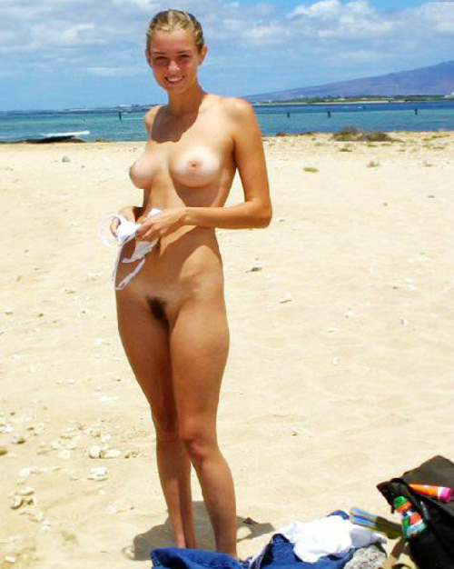 Nude pretty girl smiling at us and showing furry puss