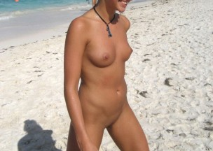 548-Sweet-happy-girl-caught-nude-walking-on-beach.jpg