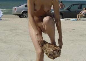 591-Frisky-blonde-undressing-on-the-beach.jpg