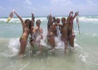 Group of sexy teens flashing everyone on the beach